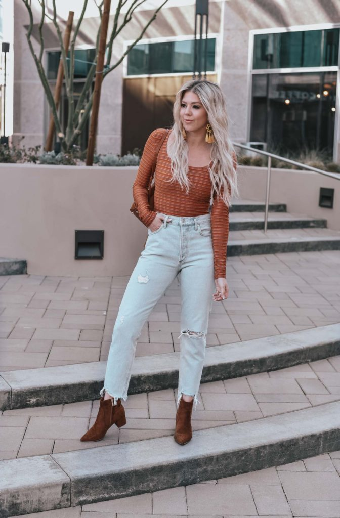 Erin Elizabeth of Wink and a Twirl shares the perfect casual look from Lulus - A pair of light high waist jeans and a striped bodysuit