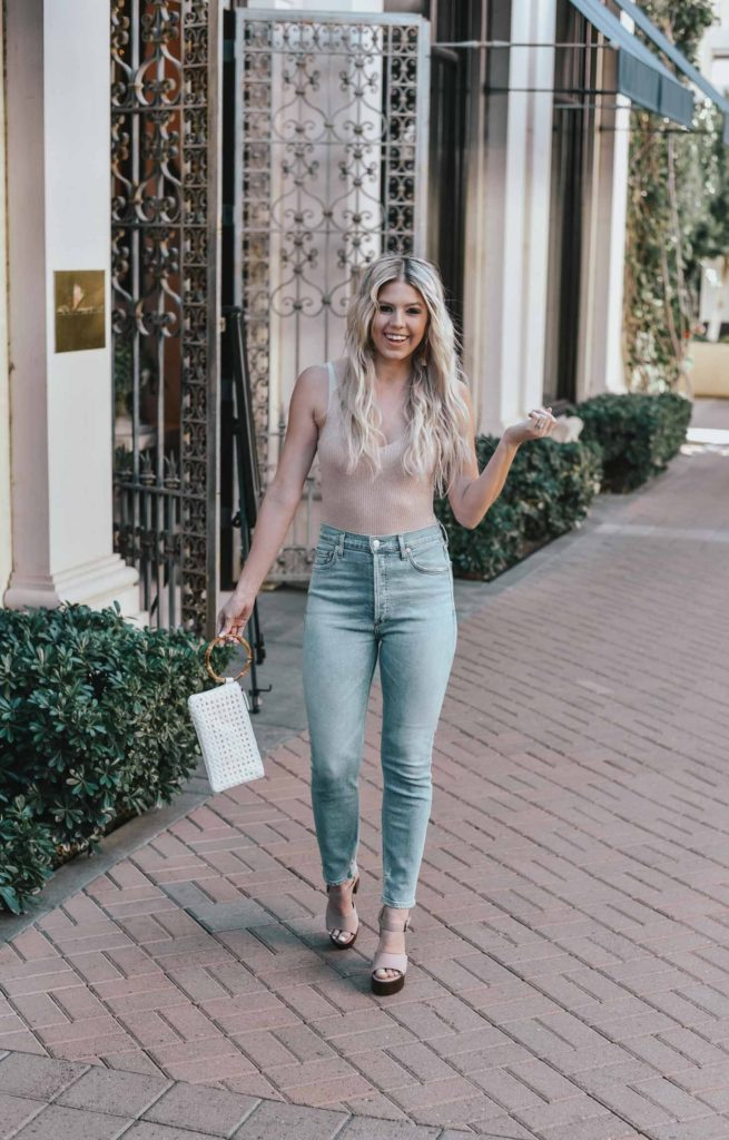 Erin Elizabeth of Wink and a Twirl shares the perfect sexy neutral bodysuit and high waist jeans from Lulus