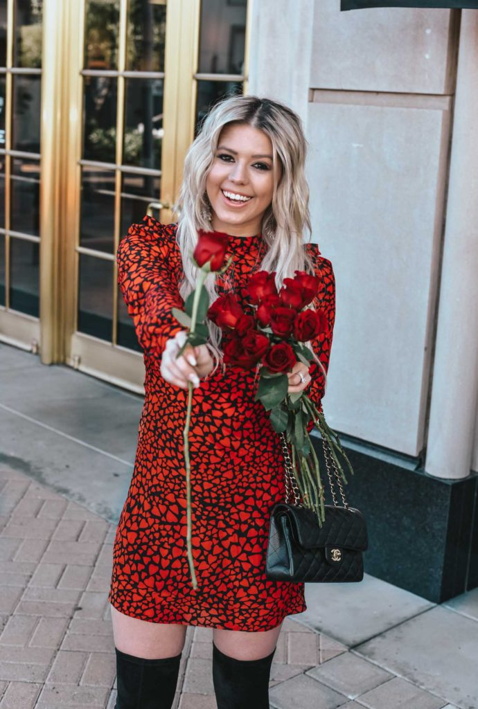 Erin Elizabeth of Wink and a Twirl shares the cutest red and black heart dress and black OTK boots for Valentine's Day from Goodnight Macaroon