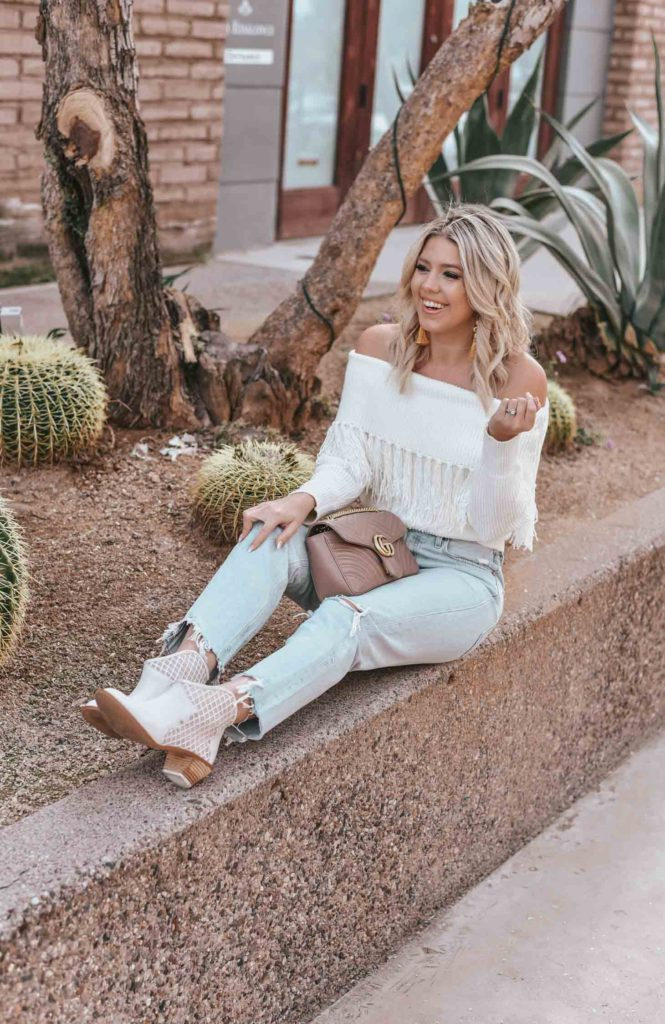Erin Elizabeth of Wink and a Twirl shares the perfect off the shoulder sweater from Amazon
