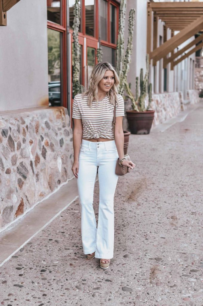 Erin Elizabeth of Wink and a Twirl shares the perfect pair of white flared jeans and neutral striped tee!