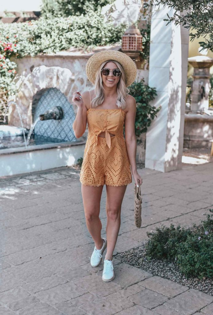 Erin Elizabeth of Wink and a Twirl shares the perfect yellow crochet-detailed cutout romper from Lulus