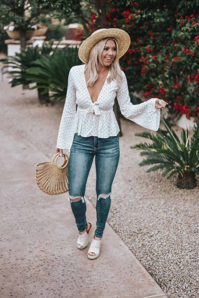 Erin Elizabeth of Wink and a Twirl shares the perfect heart top with flared sleeves from Pink Lily Boutique