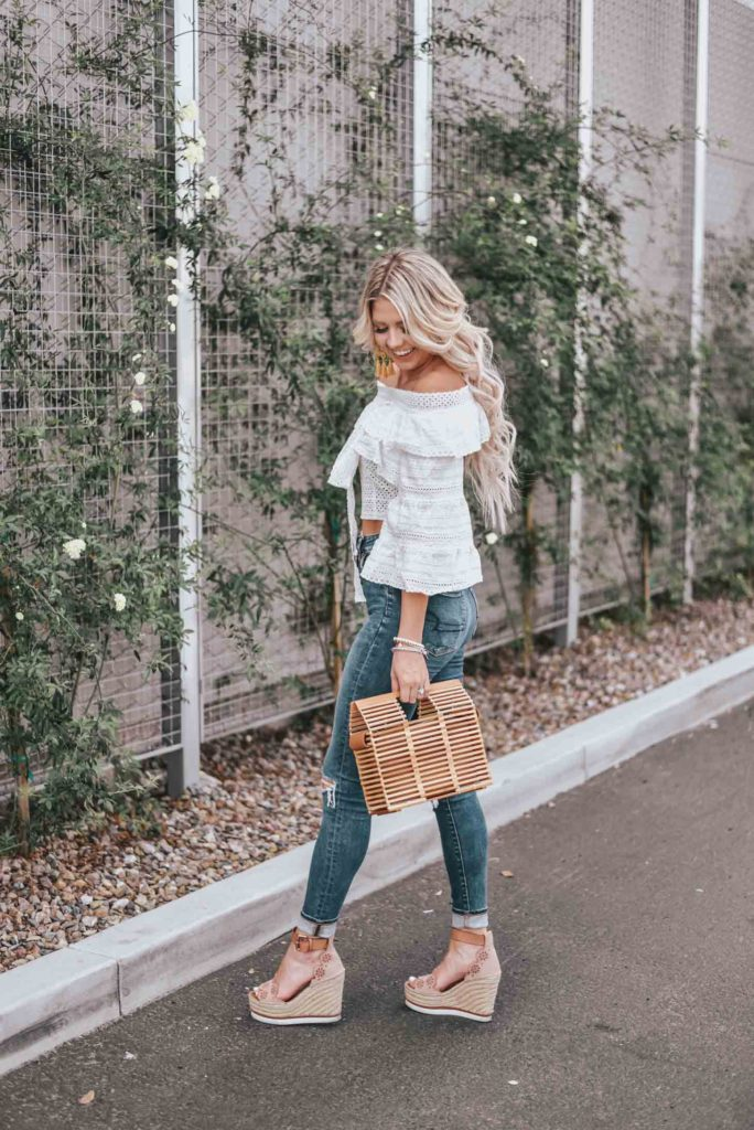 Erin Elizabeth of Wink and a Twirl shares the cutest white off the shoulder peasant top from Chicwish